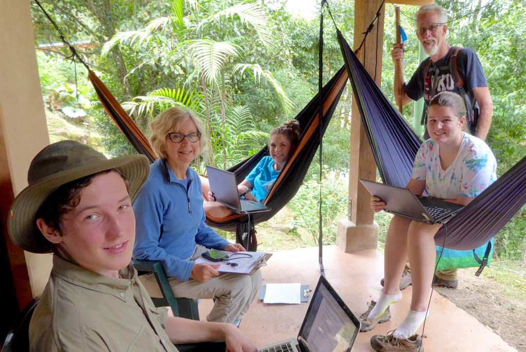 Highschool students from Kentucky working on their research projects in a tropical classroom.
